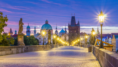 The Charles bridge is located in Prague, Czech Republic. Finished in the XV century, it is a medieval gothic bridge crossing the Vltava river. Its pillars are decorated with baroque statues of saints. Stock Photo