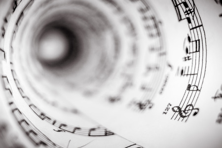 partition musique: Inside of a cone made of a music score sheet.