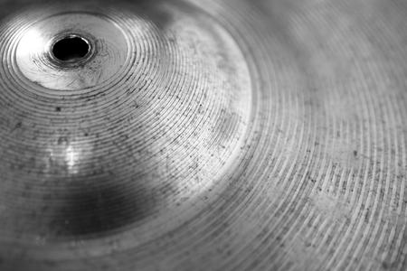 cymbal: Closeup of a shiny drum kit cymbal.