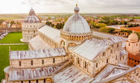 The Piazza dei Miracoli (Piazza del Duomo) is located in the city of Pisa, Tuscany, Italy. This is the view from the famous leaning tower of Pisa, showing the cathedral and the baptistry. Stock Photo