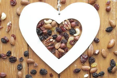 hazelnut tree: Nuts, raisins and Heart Stock Photo