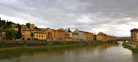 florence italy: Riverbank in Florence, Italy with the Ponte Vecchio in the distance