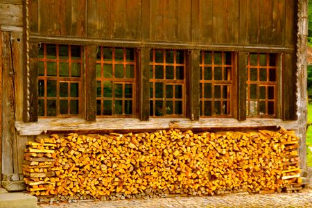 pile dwelling: Wood cut and stacked for warm winter fires