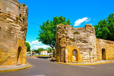 arles: Driving down a road that passes through the historic walls of Arles, France Stock Photo