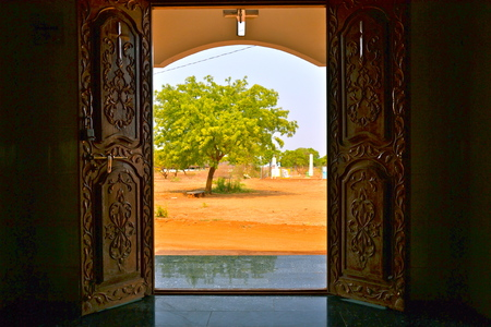 andhra: Nature beckons outside of this ornate entryway in a small village in Andhra Pradesh, India