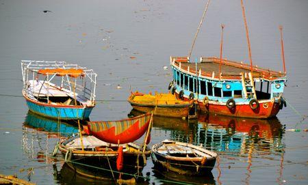 varanasi: Boats moored on the bank of the sacred Ganges River in Varanasi, India