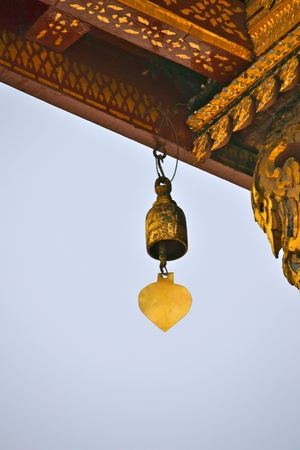 chime: An ornate chime hanging from a Wat at the Grand Palace in Bangkok, Thailand Stock Photo