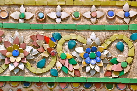 adorning: Tiles of lotus flowers adorning a temple wall at the Grand Palace in Bangkok, Thailand Stock Photo