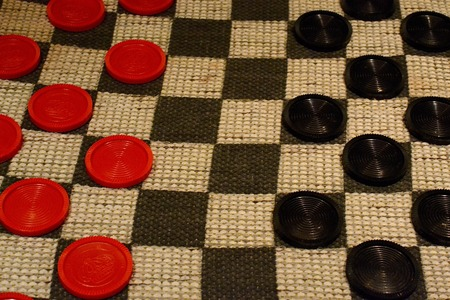 checkers: Closeup of an old-fashioned checkers game.