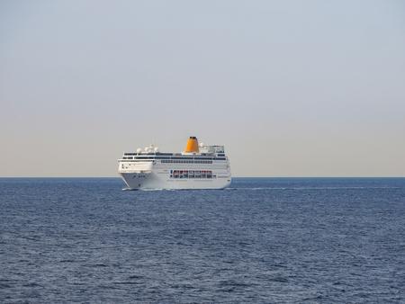 Ferryboat cruising on open ocean Stock Photo