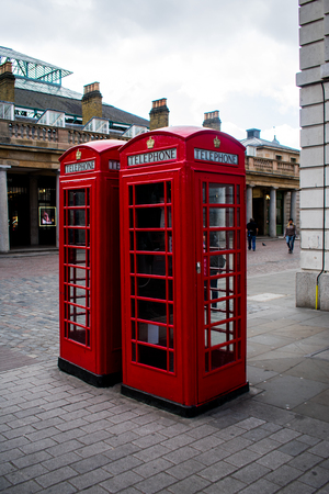 Two red telephone booths, in London Stock Photo