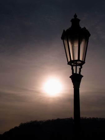 sunset with historic lamp Stock Photo