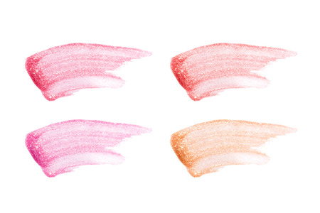 Different lip glosses isolated on white. Smudged lip gloss sample Stock Photo