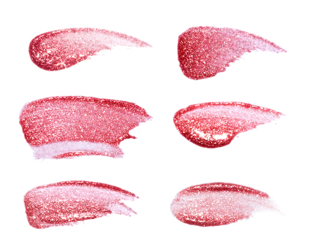 gloss: Different lip glosses isolated on white. Smudged lip gloss sample Stock Photo