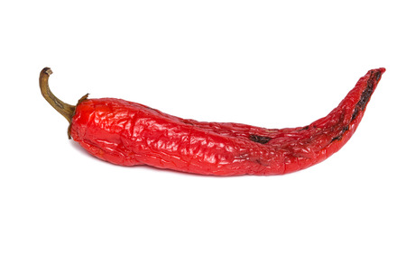 shrinking: Rotten chili pepper isolated on white background. The natural color and texture. Spoiled vegetables.