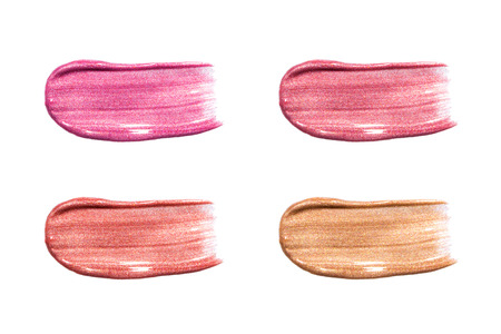 glosses: Different lip glosses isolated on white. Smudged lip gloss sample Stock Photo