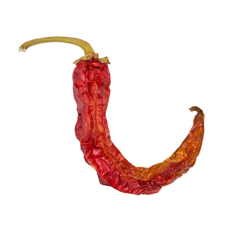 Dry chili pepper isolated on white. Dried vegetable.