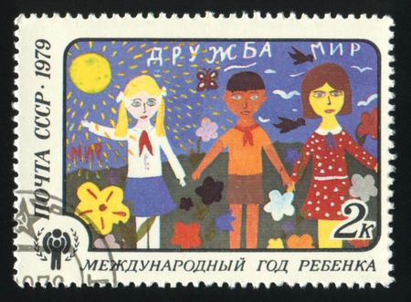 philately: USSR - CIRCA 1979: A stamp printed in USSR shows the Children drawing Friendship, from the series International Year of the Child, circa 1979 Editorial