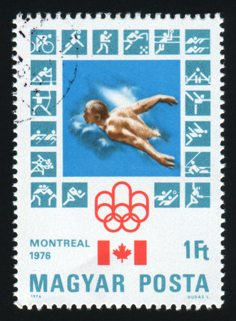 canada stamp: HUNGARY - CIRCA 1976: A postage stamp printed by Hungary, shows Montreal Olympic Emblem, Canadian Flag, Butterfly stroke, circa 1976