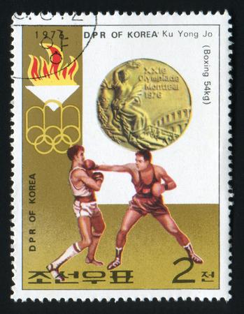 DPR KOREA - CIRCA 1973: A stamp printed in DPR Korea, shows Games of the XXI Olympiad boxing Ku Yong Jo, series, circa 1976 Editorial