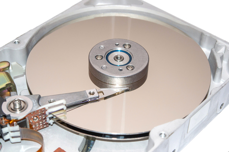 Closeup of inside of a hard disk drive HDD.