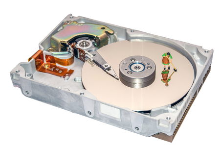 Cleaning the hard disk. A woman cleans a HDD. Figurine of a woman. Cleaners. Cleaning of computer element. Recovery of computer data. Miniature people repair the hard drive. Stock Photo