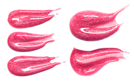 Set of different lip glosses smear isolated on white. Smudged makeup product sample