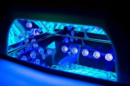 Ultraviolet lamp for drying nails. Inside the working LED-lamp