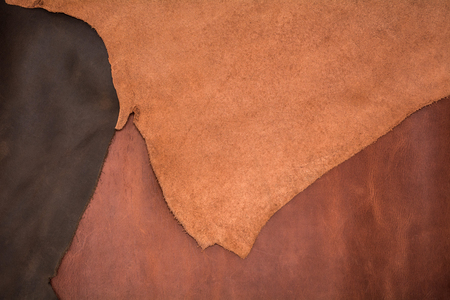 Texture of three pieces of natural brown leather. Leather background