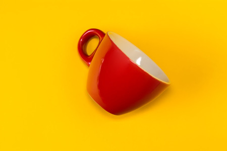 Red empty cup a yellow background. View from above. 스톡 콘텐츠