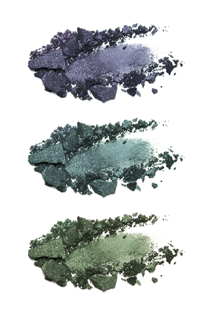 Set of eyeshadow sample isolated on white background. Crushed blue and green metallic eyeshadow. Closeup of a makeup product Banco de Imagens