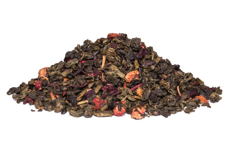 Mix of green tea with strawberry and hibiscus flowers karkade on white background Фото со стока