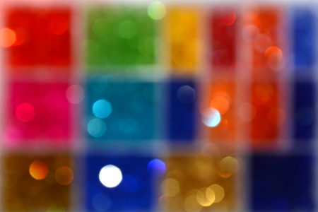 Abstract texture with multicolored bokeh. Colored squares. Blurring background.