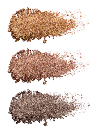 Set of bronze eye shadow strokes isolated on white background. Closeup of a makeup product. Reklamní fotografie