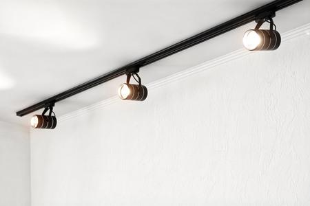 Spotlights under the ceiling on the wall. Track LED-lighting system 版權商用圖片