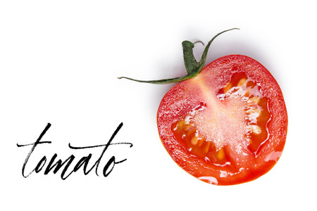 A half of tomato is isolated on a white background. View from above.