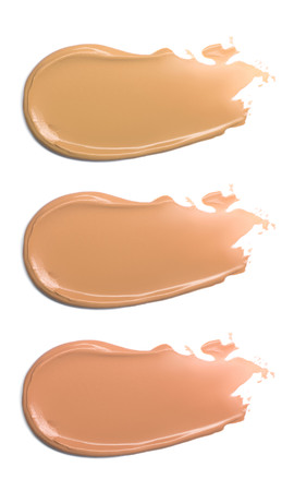 Foundation for face isolated on white. Smears of tonal cream. Set of multicolored swatches of makeup samples