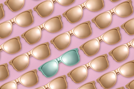 Pattern of golden sunglasses on pink background. Stock Photo