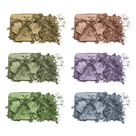 Set of eyeshadow sample isolated on white background. Crushed brown, blue, green metallic eyeshadow. Closeup of a makeup product Stock Photo
