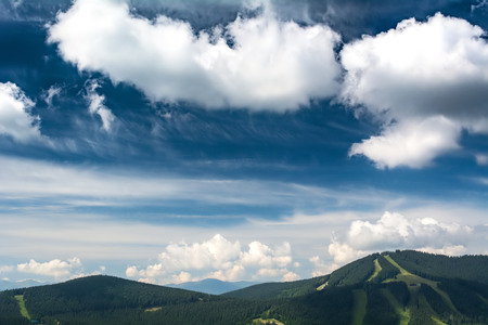 Beautiful clouds over the mountains. Summer landscape. Ukrainian Carpathians