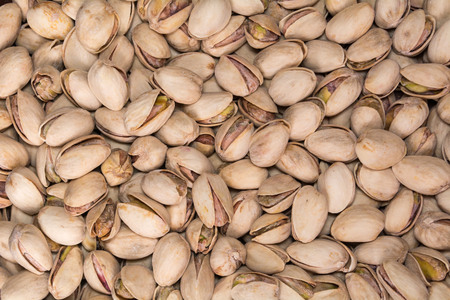 Texture of many salted pistachios. Snack. Tasty food