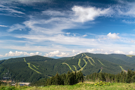 Cable car in the ski resort. Summer holidays in the mountains. Stock Photo