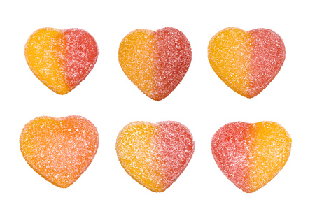 Jelly candies in the form of hearts isolated on white background.