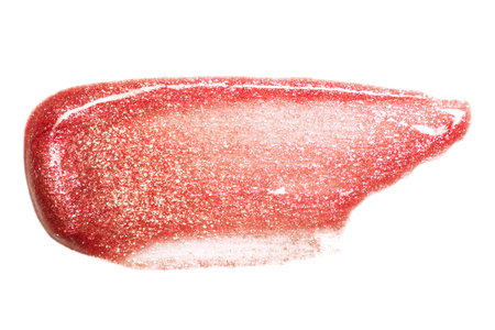 Lip gloss sample isolated on white. Smudged red lipgloss.