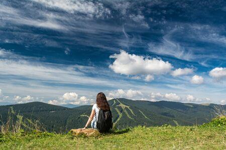 Woman on the mountainside. Rest in the Ukrainian Carpathians. Tourist place Banco de Imagens