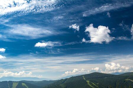 Beautiful clouds over the mountains. Summer landscape. Ukrainian Carpathians