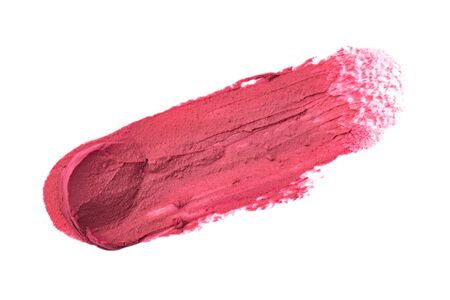 Lipstick smear isolated on white background. Makeup product sample. Reklamní fotografie