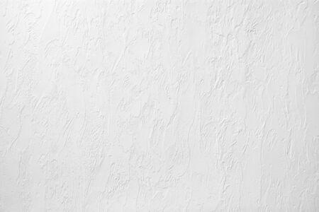 Foto di una parete intonacata bianca. Sfondo astratto Archivio Fotografico