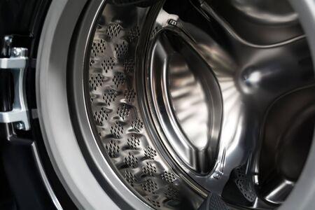 Inside a black washing machine. Inverter drum close up