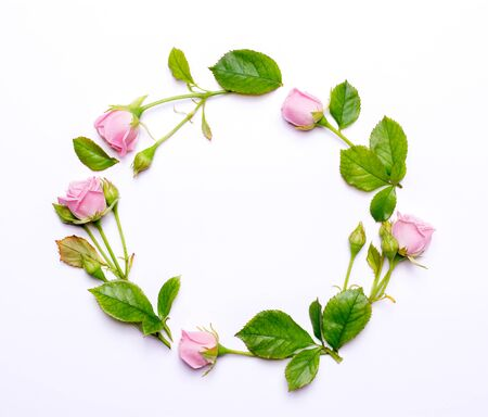 Round frame of delicate flowers. Pink roses isolated on white background. Top view, flat design.